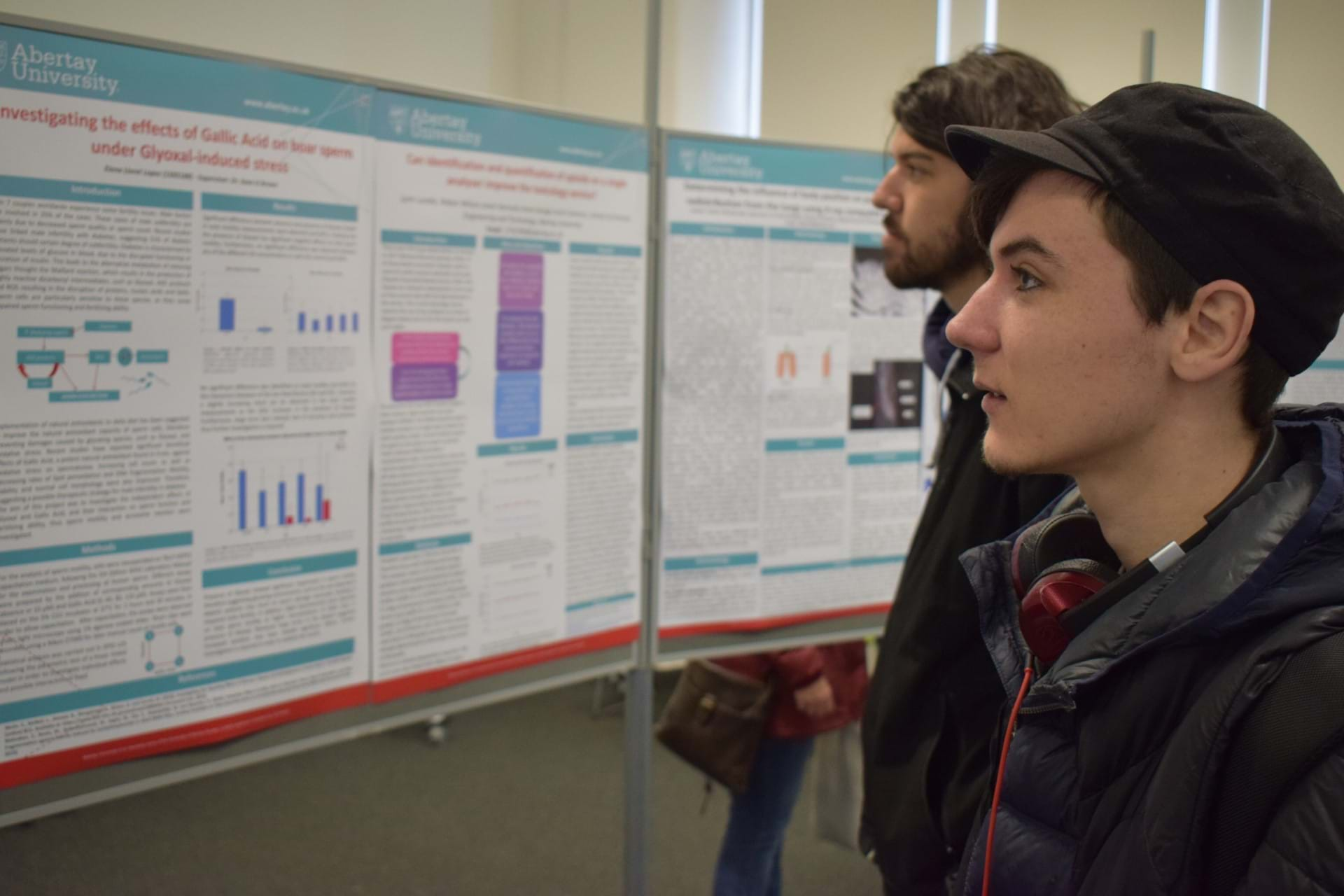 People looking at posters at the Science Degree Day
