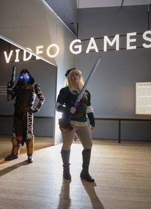 People dressed up as videogames characters inside the V&A