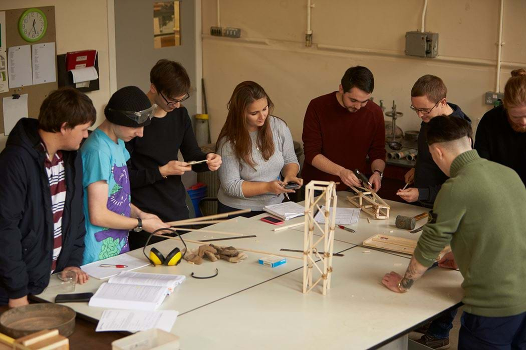 Group of engineering students working together