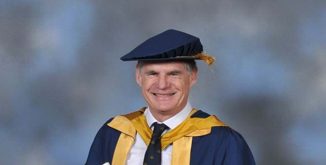 A photo of John Beattie in his graduation outfit