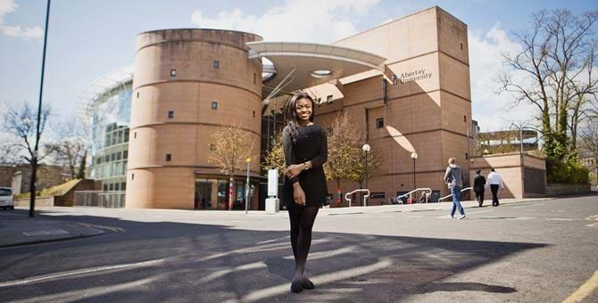 Female standing outside the Bernard King Library