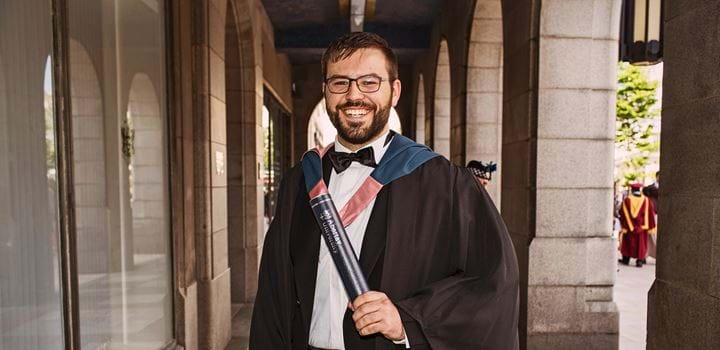 Male wearing graduation robes