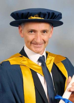 A photo of Pat Nevin in graduation uniform