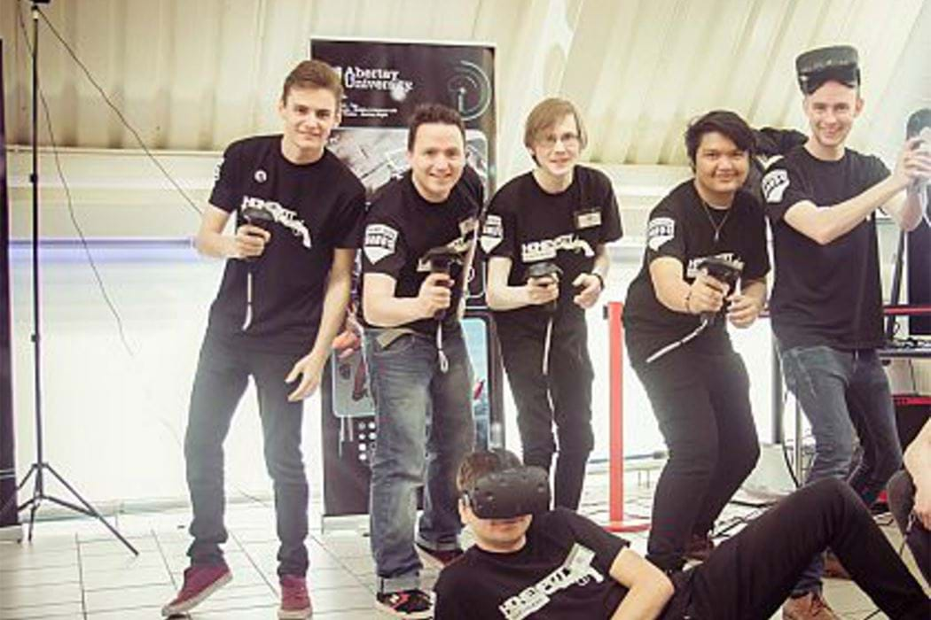 Dare team posing with VR gear.