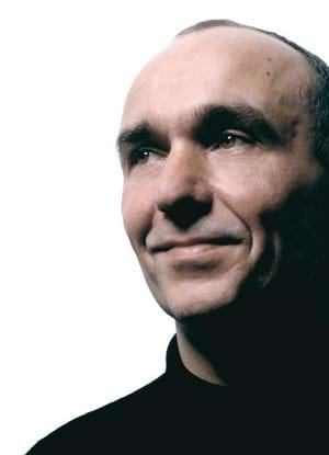 A photo of Peter Molyneux in a dark jumper