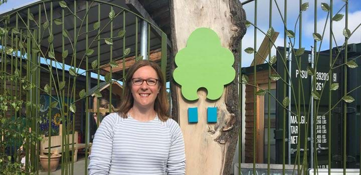 A picture of Jenny Robertson standing outside The Ecology Centre.