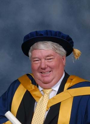 A photo of BBC Political Editor Brian Taylor in his graduation outfit