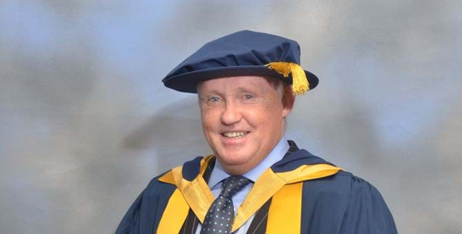A picture of Tony Banks in his graduation outfit