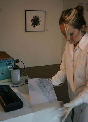Female wearing white lab coat