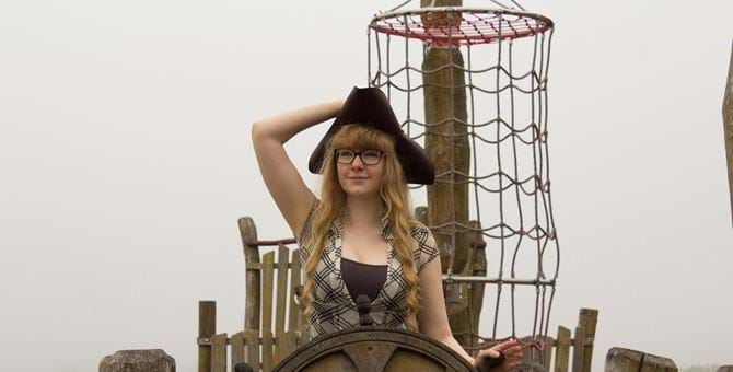 A photo of Jess Hider wearing a sea captain's hat.