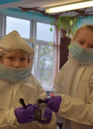 Pupils from St Mary's PS in Dundee wearing CSI suits