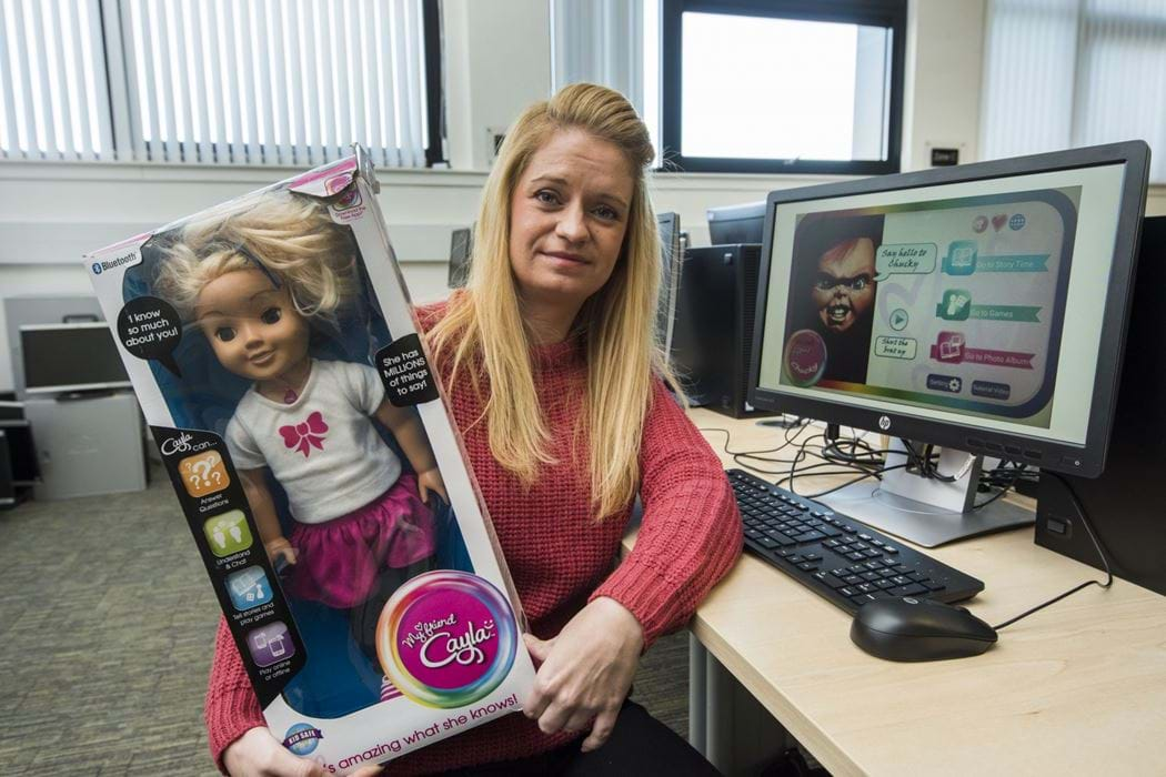 Female Ethical Hacking student Cheryl Torano with a hacked Cayla Doll