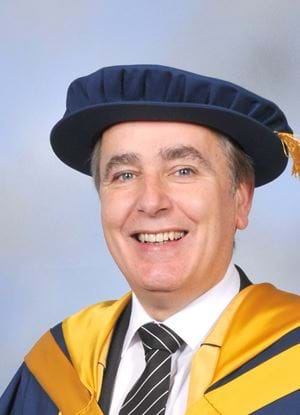 A photo of Stuart Wall in graduation outfit