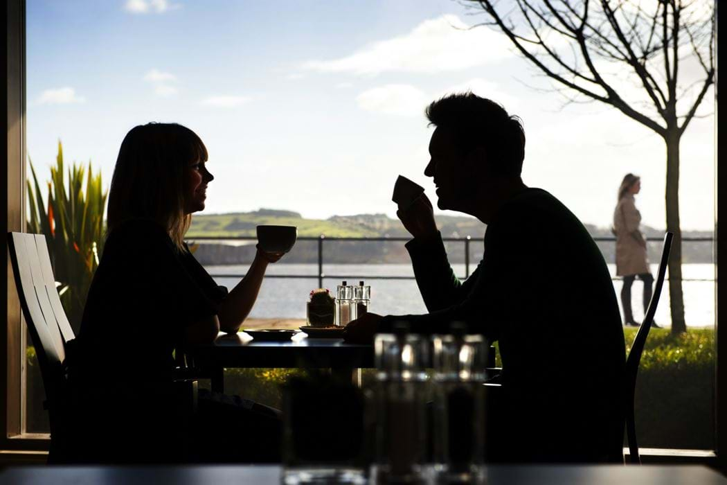 Male and female drinking coffee