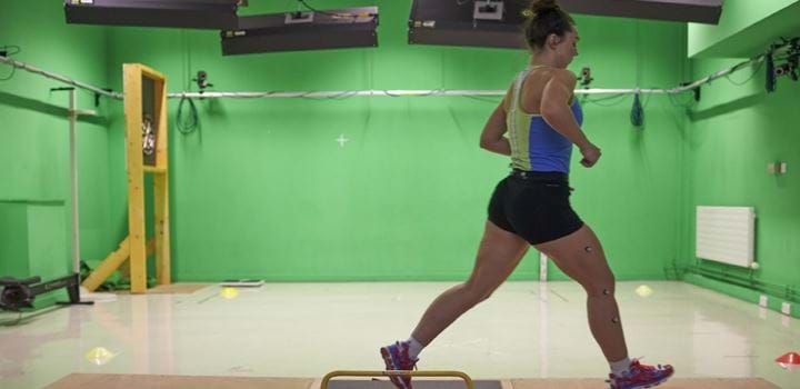 female exercising in a gym hall