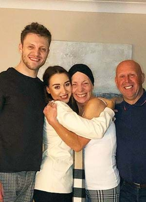 Sam, Matilda and their family, smiling