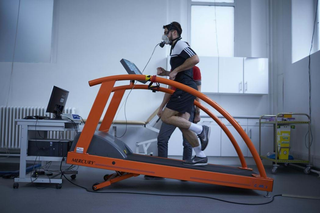 Male running on a running machine whilst wearing breathing apparatus