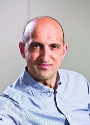 A photo of Matthew Syed in a blue shirt