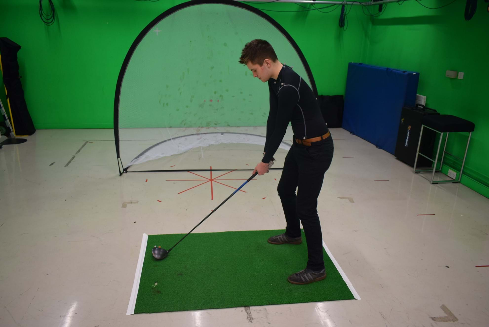 A golfer in a motion capture suit