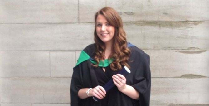 Female wearing graduation robes