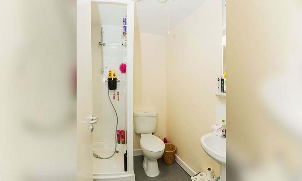 bathroom containing shower cubicle, toilet and wash hand basin