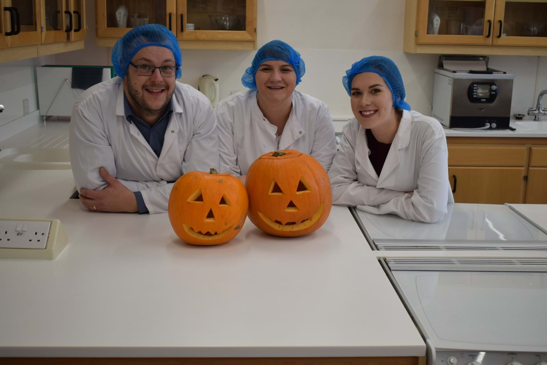 Dr Jon Wilkin and students Megan Burns and Aileen McColm with carved pumpkins