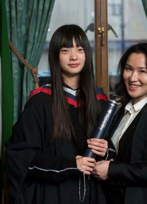 A photo of Lili Liu with her degree