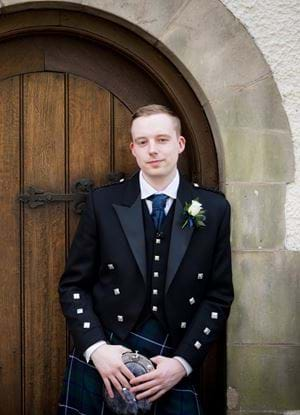A picture of Grant Douglas in a kilt on his wedding day