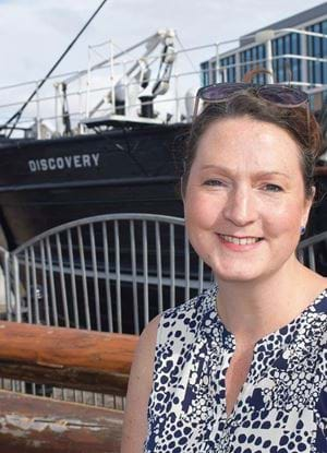 Rebecca Wade, Senior Lecturer Abertay university, stood in front of the RRS Discovery, Dundee.