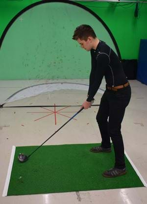 A golfer wearing a motion capture suit