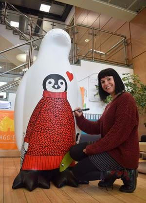 Suzanne Scott/Whimsical Lush painting Abertay's penguin for Maggie's Penguin Parade