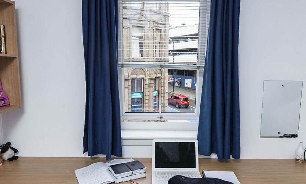 Desk with laptop on top - with a view out of the window